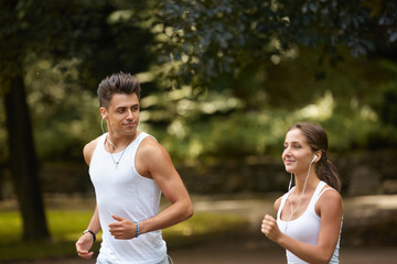 Portrait of  Caucasian couple running outdoors
