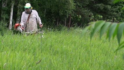 villager cut grass with handheld power trimmer, focus change
