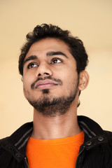 Indian young handsome man in thinking posture