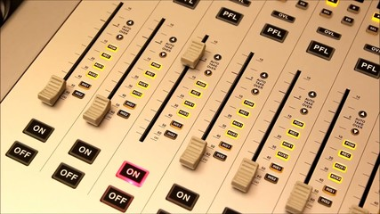 Raising the volume on a broadcast mixer