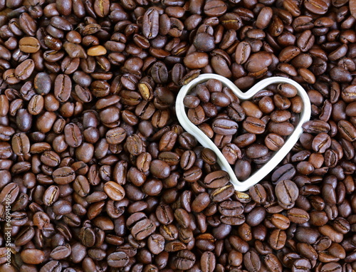 background of coffee beans with a white heart