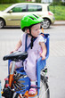 Child sits strapped in the seat bicycle