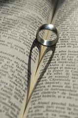 Ring casting a heart-shaped shadow in a book