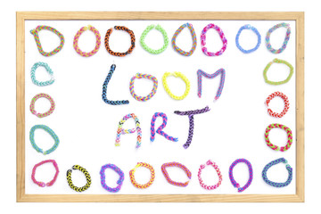 Loom Band Bracelets on a White Board Isolated