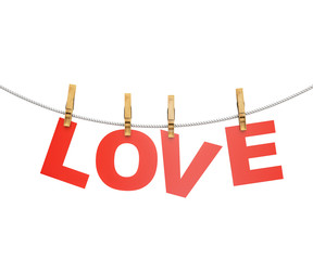 red love letters hanging on rope with clothespins