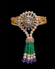 Close - up of gold and diamond bracelet with pearls