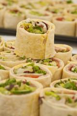 Tray of sliced pitta rolls