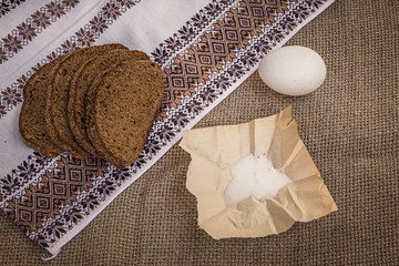Rye bread, egg and salt on canvas
