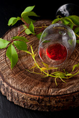 Red wine in glass on wooden board