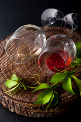 Glasses of wine on dark background