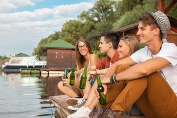 Friends Chilling Near Lake