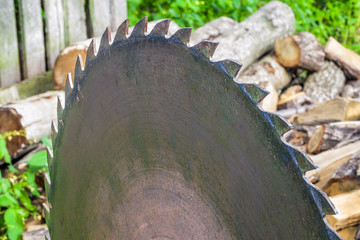 Circular saw at outdoors with the wood around