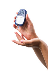 glucometer in woman's hand