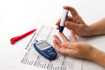 woman's hands and glucometer