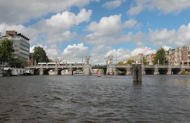 "Bridge ""Hoge Sluis"" through river Amstel. Amsterdam, Holland"