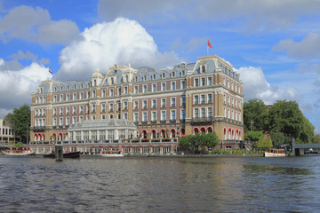 Ancient building on river bank. Amsterdam, Holland