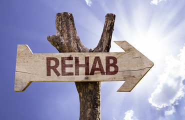 Rehab wooden sign on a beautiful day