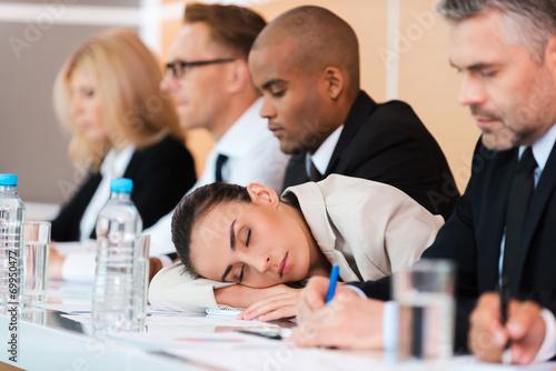Leinwanddruck Bild Sleeping at the conference.