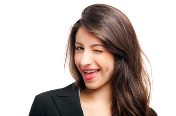 Young woman winking at you
