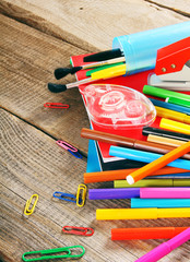 School tools. On wooden background.