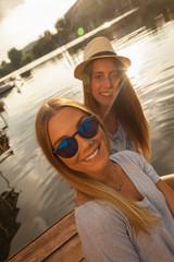Two Girls Taking Selfie Near River
