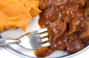 Beef and sweet potato TV dinner with fork