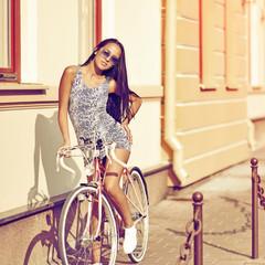 Beautiful woman riding on bike
