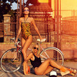 canvas print picture - Two sexy model girls posing near a vintage bike. Outdoor fashion