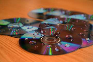Compact disks splattered by water
