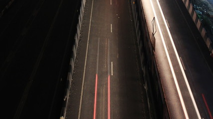 Highway traffic driving speed time lapse color light on street