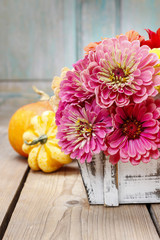 Bouquet of zinnia flowers in wooden box