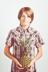 child with fresh pineapple