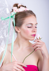 Young woman with rose, marshmallow makeup style, beauty fantasy.