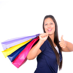Young beautiful shopping woman on sale holding many colorful sho