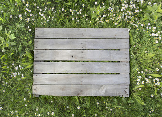 Wooden background on grass