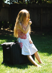 Girl and suitcase.