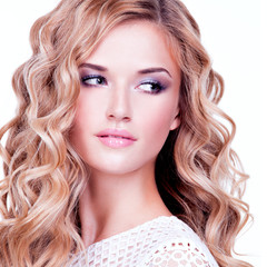 Closeup portrait of pretty blonde girl with wavy  hairs