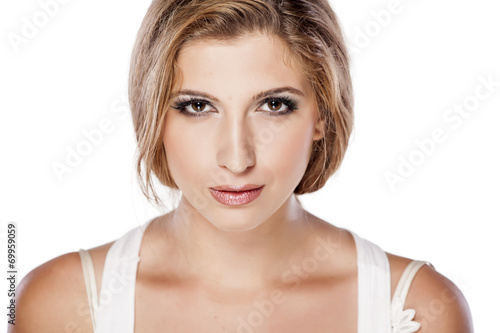 canvas print picture Headshot of serious girl on white background