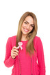 Young woman in pink sweater holding breast cancer ribbon