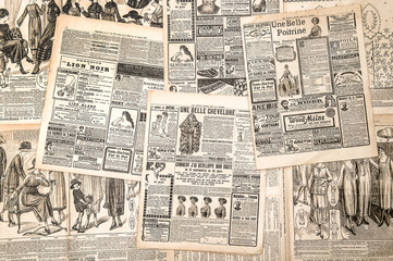 Newspaper pages with antique advertising. Woman's fashion magazi