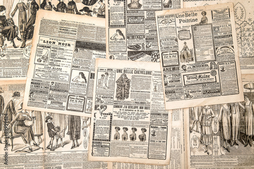 Newspaper pages with antique advertising. Woman's fashion magazi © LiliGraphie