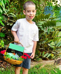 Young boy with a Basket of Fruit and Flowers for Shavuot