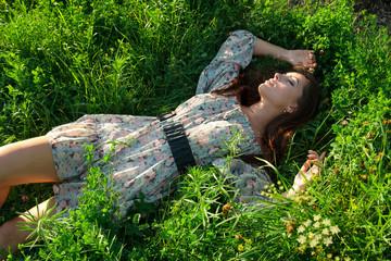 Beautiful girl on the green grass