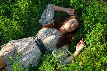 Cute girl on the green grass