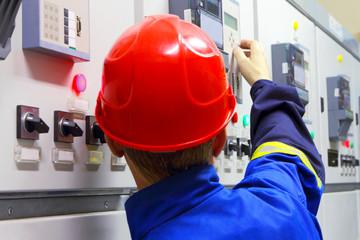 Worker in a helmet, the electrician