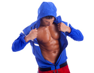 Fitness man showing six pack abs on a white background