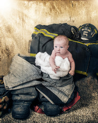 baby in a firemans boot with hat and textured background