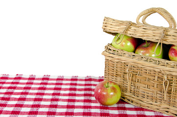 apples in wicker picnic basket