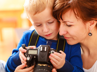 Mother and child playing with camera taking photo