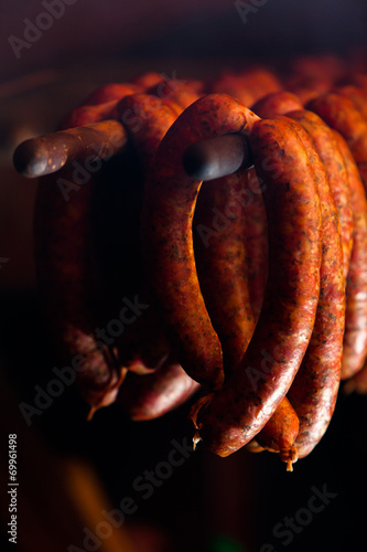 Traditional food. Smoked sausuages in smokehouse. - 69961498